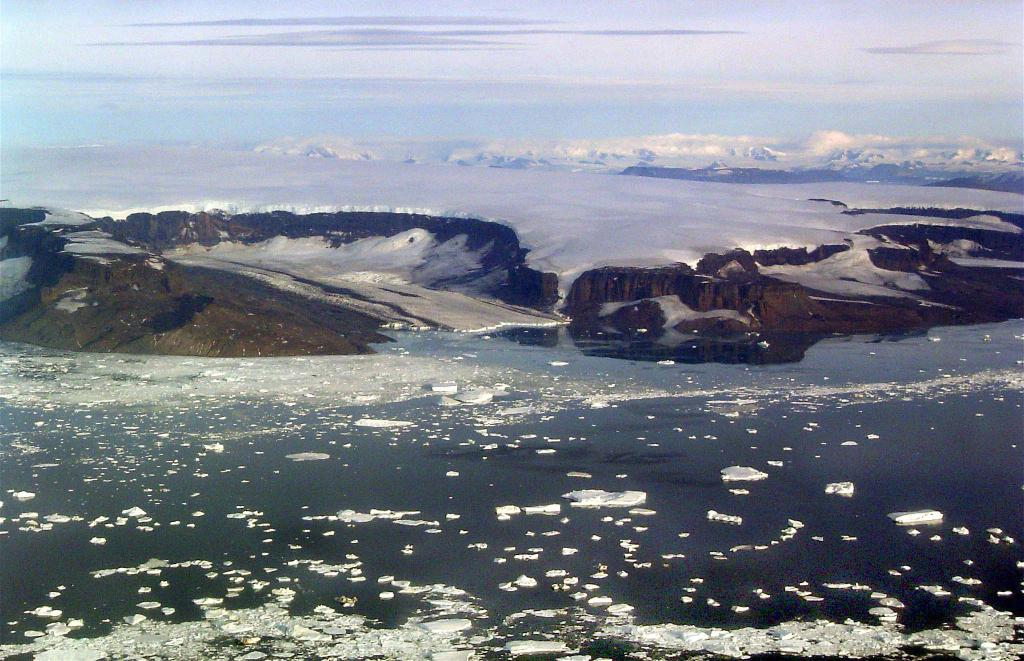 "This in-flight photo shows James Ross Island. Photo Credit: Courtesy Ted Scambos and Rob Bauer, NSIDC  <a href=""http://nsidc.org/icetrek"">IceTrek Web site</a> (<a href=""/cryosphere/gallery/photo/32907"">View photo detail.</a>) <br>"