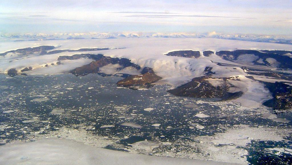 "This in-flight photo shows James Ross Island. Photo Credit: Courtesy Ted Scambos and Rob Bauer, NSIDC  <a href=""http://nsidc.org/icetrek"">IceTrek Web site</a> (<a href=""/cryosphere/gallery/photo/32906"">View photo detail.</a>) <br>"