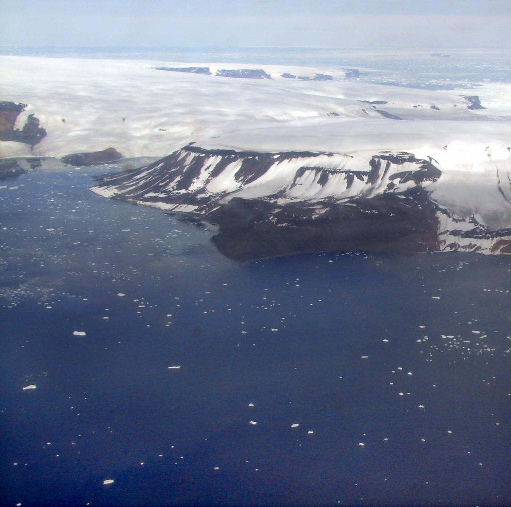 "This in-flight photo shows James Ross Island. Photo Credit: Courtesy Ted Scambos and Rob Bauer, NSIDC  <a href=""http://nsidc.org/icetrek"">IceTrek Web site</a> (<a href=""/cryosphere/gallery/photo/32908"">View photo detail.</a>) <br>"