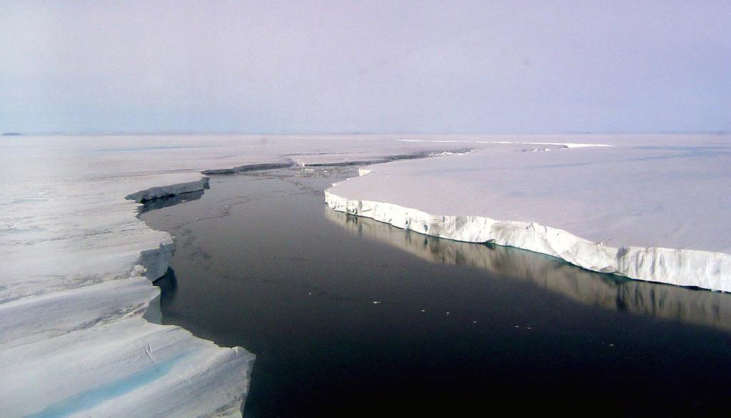 "This in-flight photo shows the edge of the Larsen B Ice Shelf. PhotoCredit: Courtesy Ted Scambos and Rob Bauer, NSIDC  <a href=""http://nsidc.org/icetrek"">IceTrek Web site</a> (<a href=""/cryosphere/gallery/photo/32911"">View photo detail.</a>) <br>"