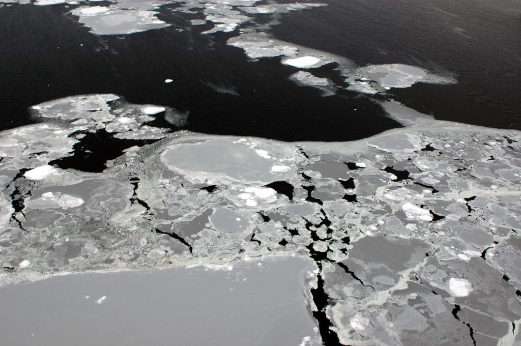 "Sea ice and icebergs combine to form patterns. Photo Credit: Courtesy Ted Scambos and Rob Bauer, NSIDC  <a href=""http://nsidc.org/icetrek"">IceTrek Web site</a> (<a href=""/cryosphere/gallery/photo/32918"">View photo detail.</a>) <br>"