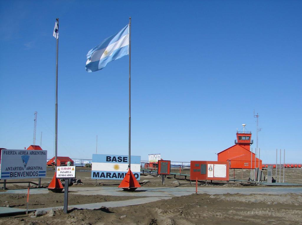 "The flags of Marambio Base fly high and proud on a clear-weathered day. Photo Credit: Courtesy Ted Scambos and Rob Bauer, NSIDC  <a href=""http://nsidc.org/icetrek"">IceTrek Web site</a> (<a href=""/cryosphere/gallery/photo/33350"">View photo detail.</a>) <br>"