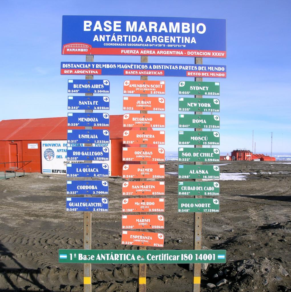 "The sign at Marambio Station shows where certain cities and stations are located relative to Marambio. Photo Credit: Courtesy Ted Scambos and Rob Bauer, NSIDC  <a href=""http://nsidc.org/icetrek"">IceTrek Web site</a> (<a href=""/cryosphere/gallery/photo/33353"">View photo detail.</a>) <br>"
