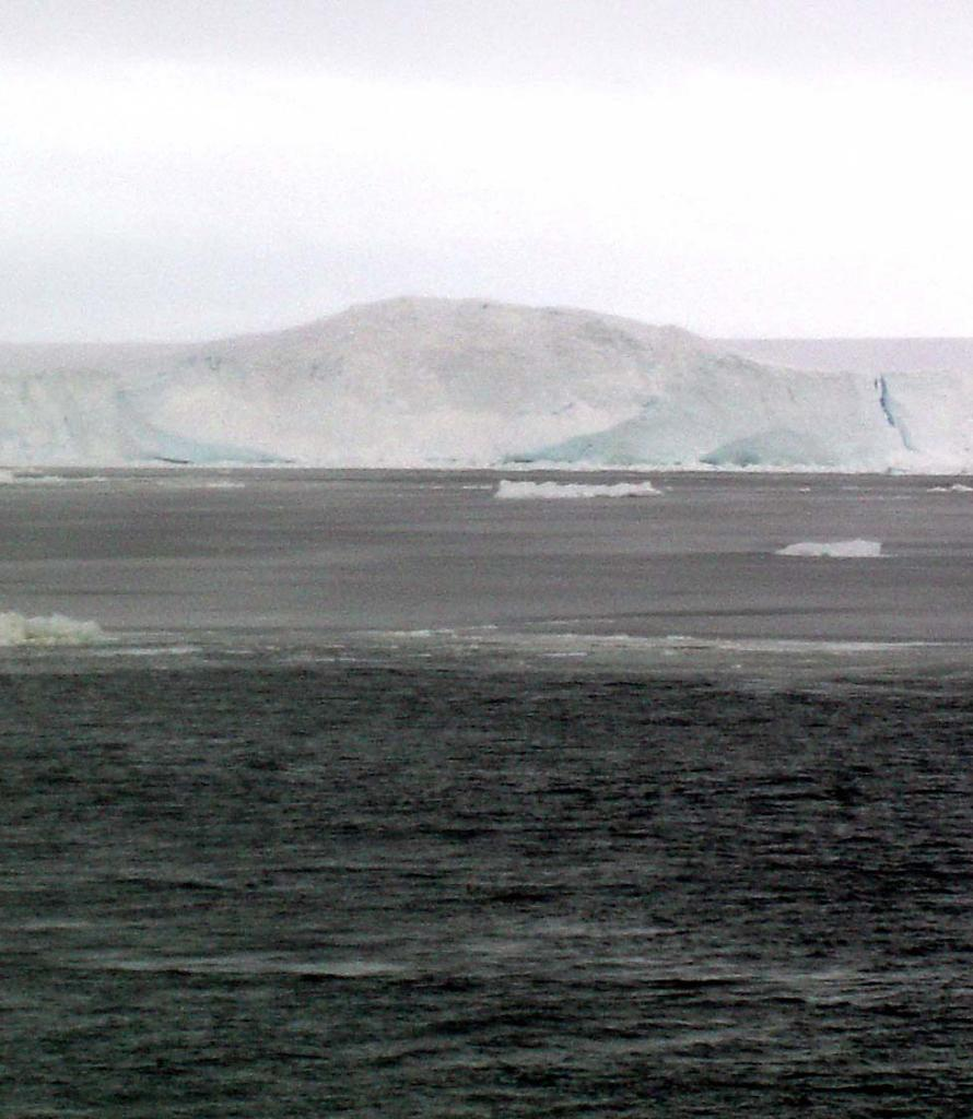 "This bump at the edge of AMIGOSberg is known as a push mound or a bumper mark. This phenomenon occurs when icebergs bump into other icebergs or land. Photo Credit: Courtesy Ted Scambos and Rob Bauer, NSIDC  <a href=""http://nsidc.org/icetrek"">IceTrek Web site</a> (<a href=""/cryosphere/gallery/photo/32938"">View photo detail.</a>) <br>"