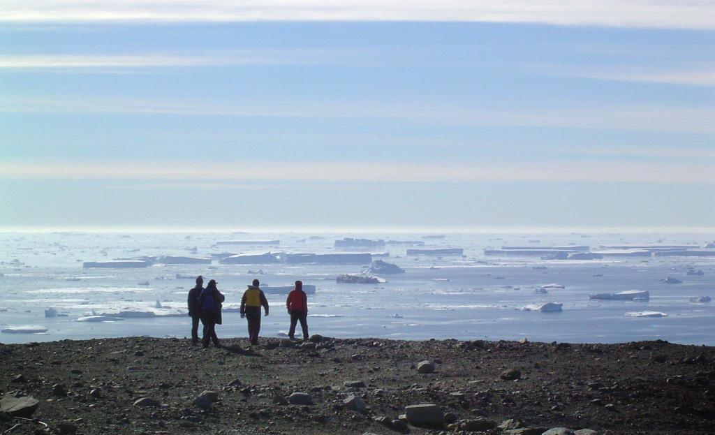 "The IceTrek team walksalong the coast of Seymour Island, taking in the view that Marambio Base has to offer. Photo Credit: Courtesy Ted Scambos and Rob Bauer, NSIDC  <a href=""http://nsidc.org/icetrek"">IceTrek Web site</a> (<a href=""/cryosphere/gallery/photo/32943"">View photo detail.</a>) <br>"