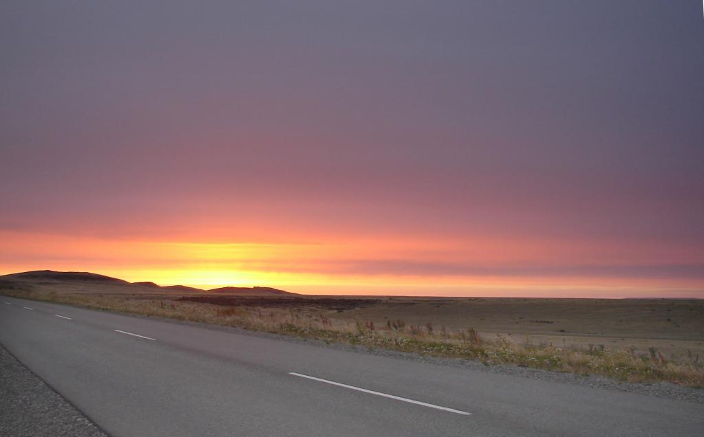"Along the way to Perito Moreno Glacier from Rio Gallegos in Argentina, the team stops to catch the sunrise on the roadside. Photo Credit: Courtesy Ted Scambos and Rob Bauer, NSIDC  <a href=""http://nsidc.org/icetrek"">IceTrek Web site</a> (<a href=""/cryosphere/gallery/photo/33379"">View photo detail.</a>) <br>"