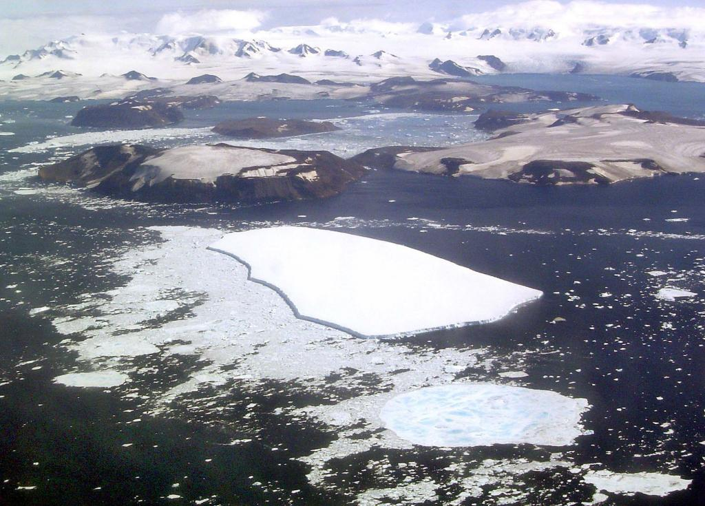 "This in-flight photo shows Vegaberg (foreground), Vega Island (midground), and the Trinity Peninsula (background). Photo Credit: Courtesy Ted Scambos and Rob Bauer, NSIDC  <a href=""http://nsidc.org/icetrek"">IceTrek Web site</a> (<a href=""/cryosphere/gallery/photo/32946"">View photo detail.</a>) <br>"