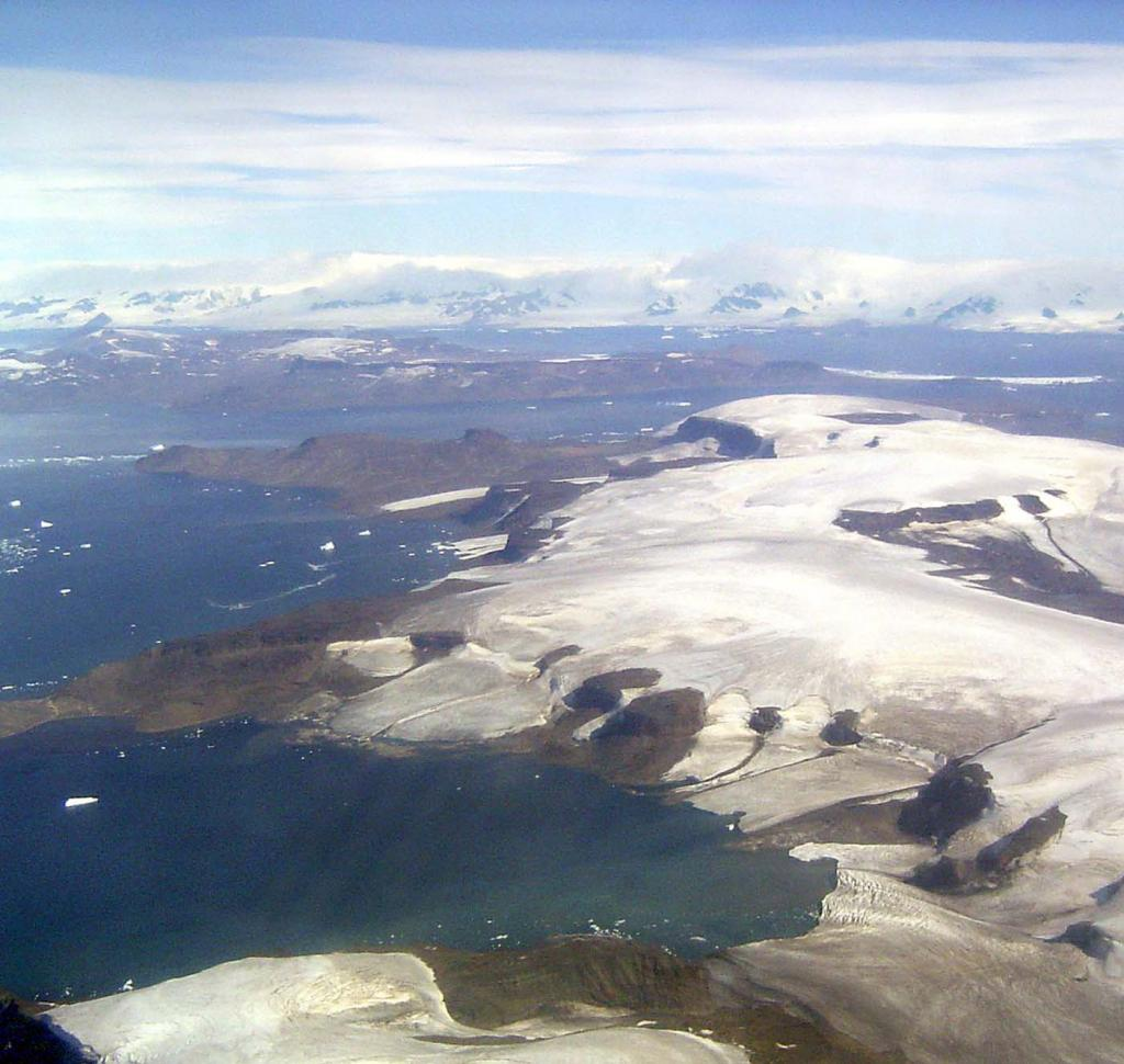 "This in-flight photo shows Vega Island (foreground), James Ross Island (midground), and the Antarctic coast (background). Photo Credit: Courtesy Ted Scambos and Rob Bauer, NSIDC  <a href=""http://nsidc.org/icetrek"">IceTrek Web site</a> (<a href=""/cryosphere/gallery/photo/32951"">View photo detail.</a>) <br>"