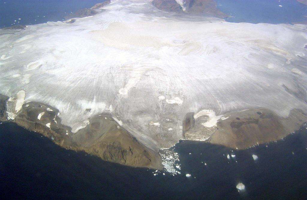"This in-flight view shows Vega Island. Photo Credit: Courtesy Ted Scambos and Rob Bauer, NSIDC  <a href=""http://nsidc.org/icetrek"">IceTrek Web site</a> (<a href=""/cryosphere/gallery/photo/32956"">View photo detail.</a>) <br>"