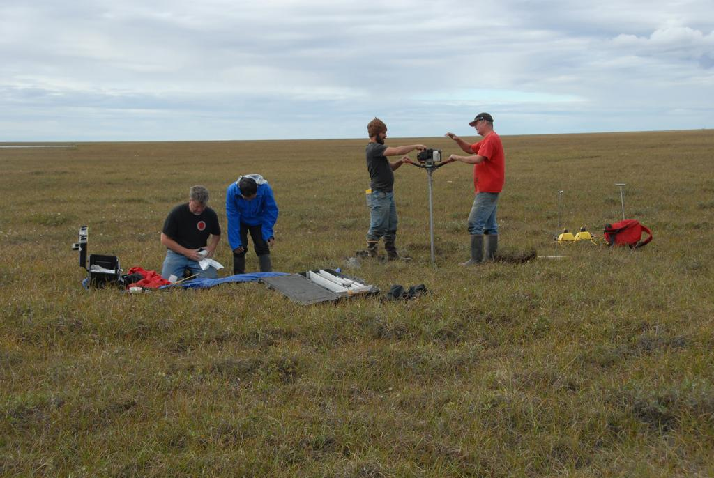 "Kevin Schaefer and Lin Liu photograph and wrap permafrost core samples on August 17, 2012 while Alessio Gusmeroli and Tim Schaefer drill more permafrost core samples. (Credit: Tingjun Zhang, NSIDC) (<a href=""/cryosphere/gallery/photo/34175"">View photo detail.</a>) <br>"
