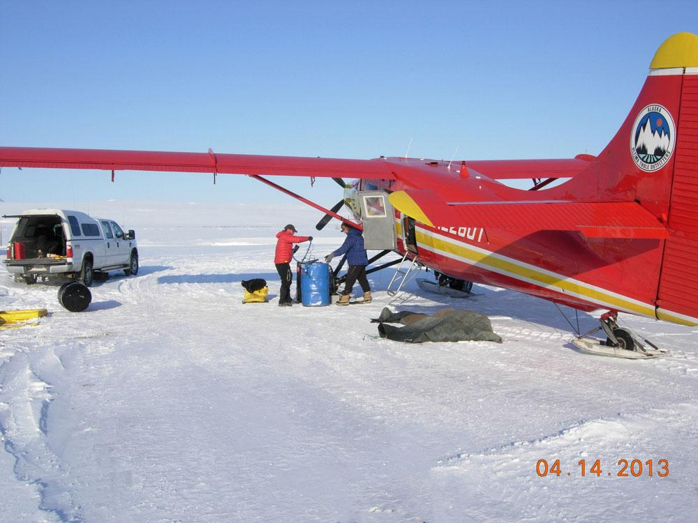 "Field camp crew check the research plane on standby during the 2013 Arctic Observing Network (Snownet) fieldwork in Alaska. (<a href=""/cryosphere/gallery/photo/34114"">View photo detail.</a>) <br>"