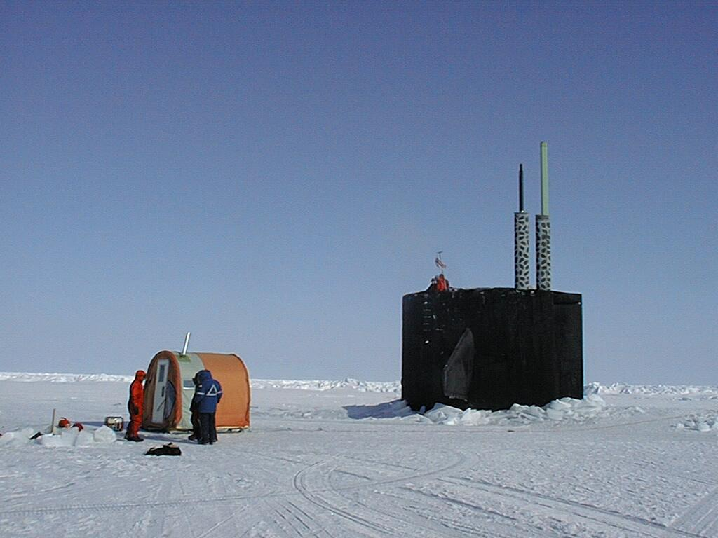 "Warming tent set up adjacent to the USS Hawkbill during SCICEX 99. Although no surface sampling was performed during SCICEX 99, a film crew from the National Geographic Society, in collaboration with Dr. Tom Lehman (LDEO), lowered cameras through a hole in the ice next to the submarine to photograph its descent. Photo courtesy of ASL. (<a href=""/cryosphere/gallery/photo/34004"">View photo detail.</a>) <br>"