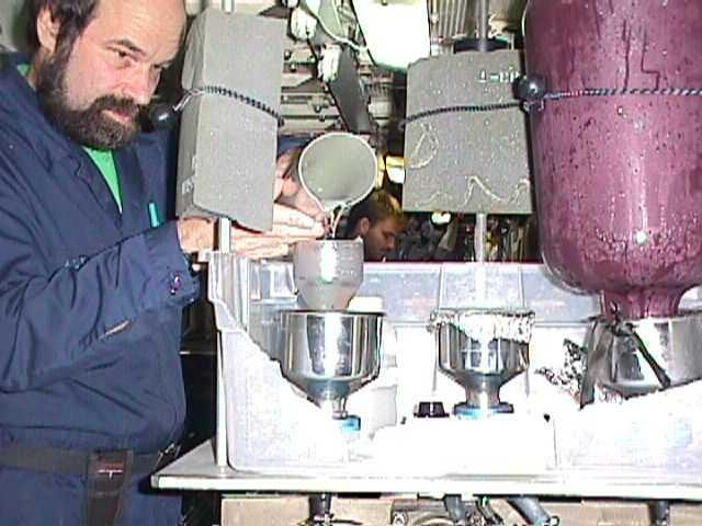 "Scientist performing chemistry analysis of Arctic Ocean water by pouring it into a filtration assembly during SCICEX 98. Photo courtesy of ASL. (<a href=""/cryosphere/gallery/photo/33998"">View photo detail.</a>) <br>"