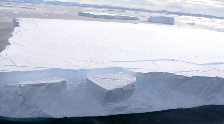 "This tabular iceberg was photographed near Antarctica during the IceTrek expedition in 2006. Photo Credit: Courtesy Ted Scambos, NSIDC <a href=""http://nsidc.org/icetrek/"">IceTrek Web site</a> (<a href=""/cryosphere/gallery/photo/32864"">View photo detail.</a>) <br>"