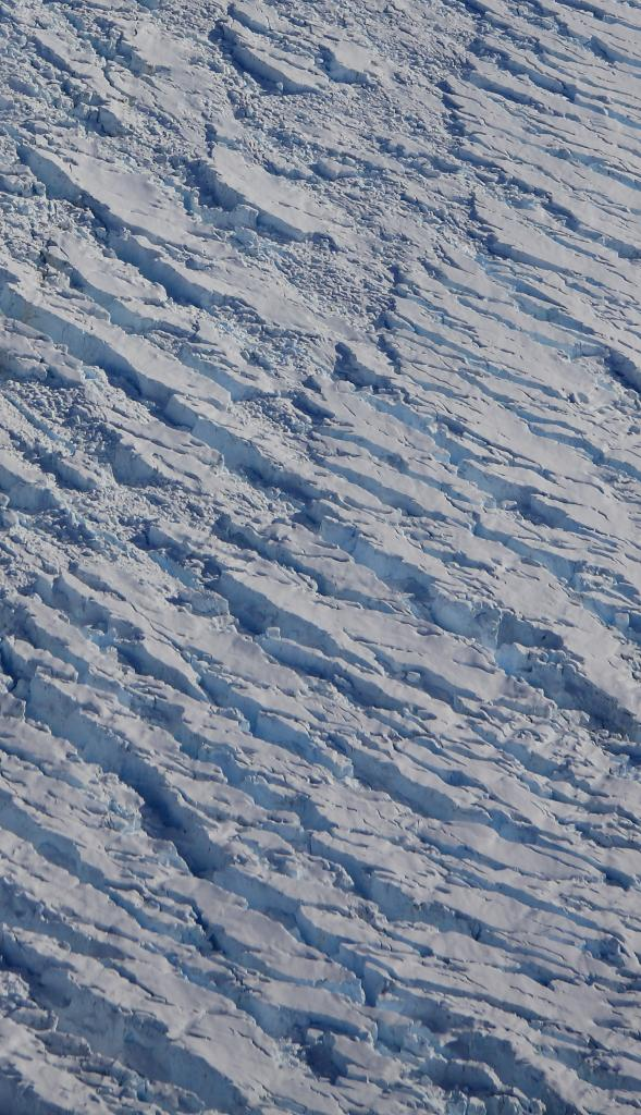 "Deep crevasses break the surface of Crane Glacier in Antarctica (<a href=""/cryosphere/gallery/photo/33950"">View photo detail.</a>) <br>"