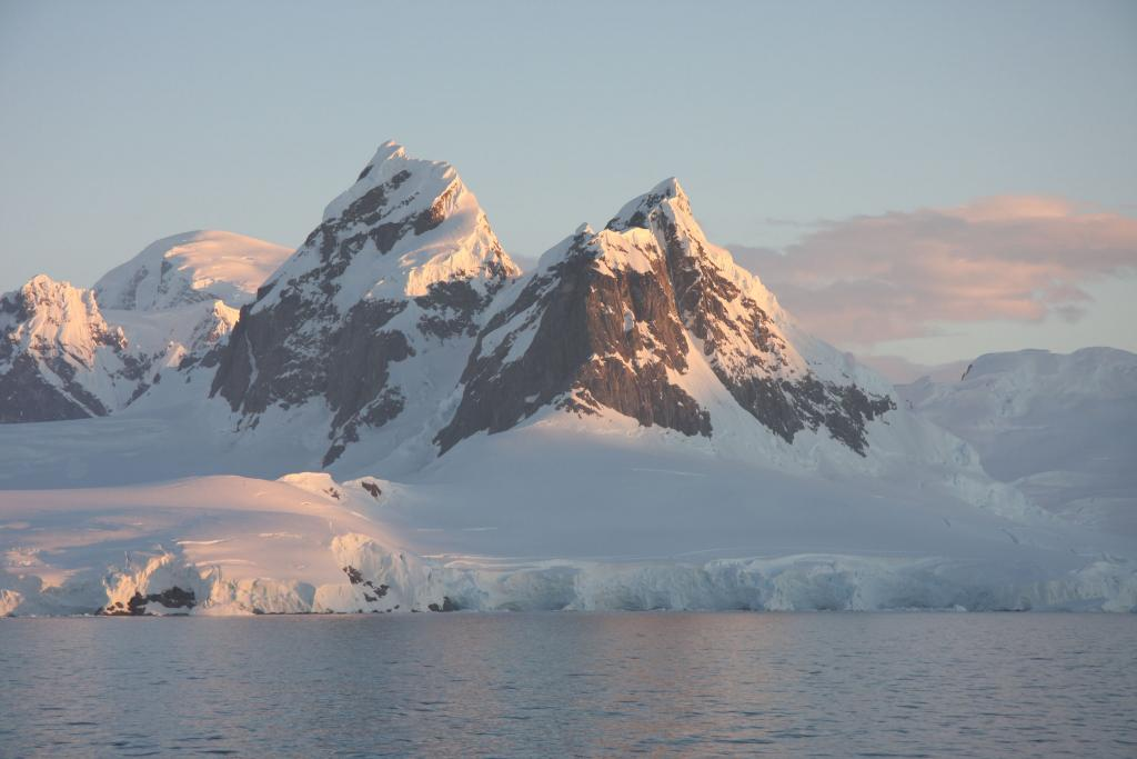 "Steep mountains rise out of the ice sheet in Graham Land, Antarctica. (<a href=""/cryosphere/gallery/photo/33959"">View photo detail.</a>) <br>"