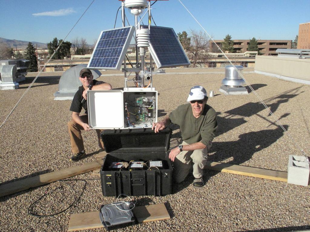 "Rob Bauer and Terry Haran pose in front of the test AMIGOS station on the NSIDC roof. (<a href=""/cryosphere/gallery/photo/33966"">View photo detail.</a>) <br>"