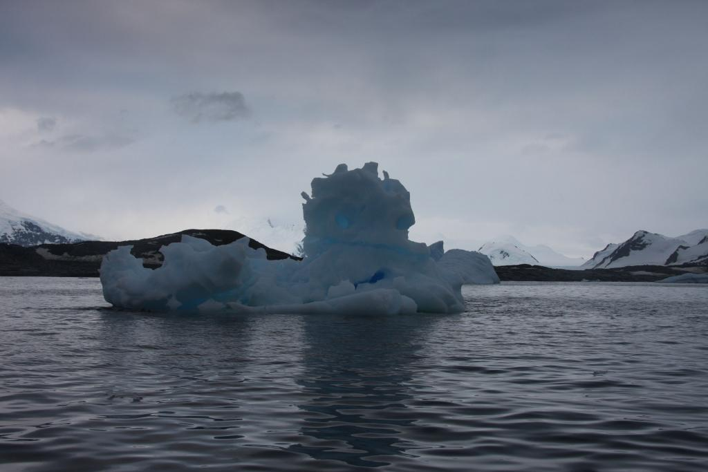 "An iceberg floats in the ocean near the Antarctic Peninsula (<a href=""/cryosphere/gallery/photo/33936"">View photo detail.</a>) <br>"