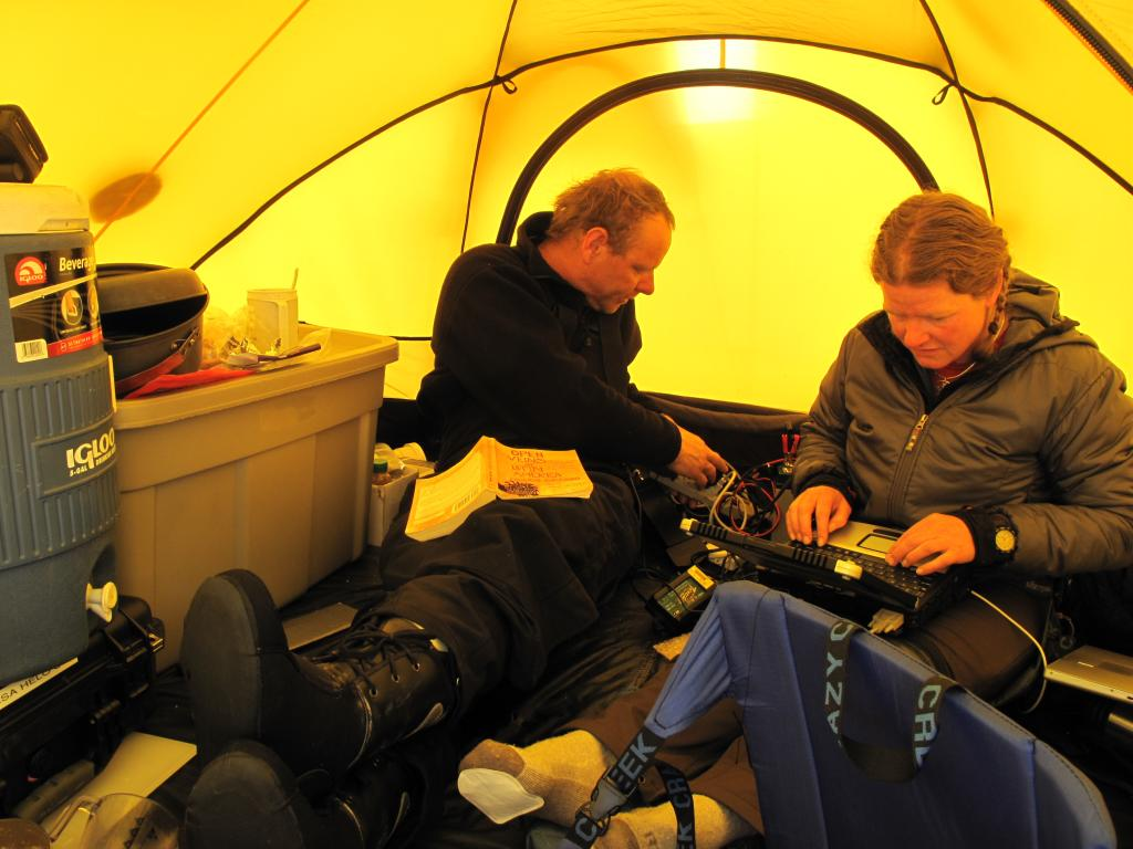 "Martin Truffer and Erin Pettit, of UAF, work in the tent during the LARISSA expedition. (<a href=""/cryosphere/gallery/photo/33942"">View photo detail.</a>) <br>"