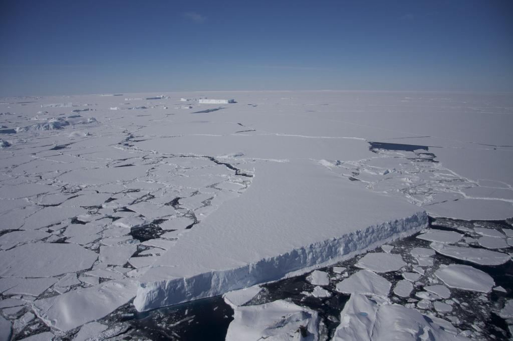 "Sea ice surrounds a tabular ice berg near the Antarctic Peninsula (<a href=""/cryosphere/gallery/photo/33939"">View photo detail.</a>) <br>"
