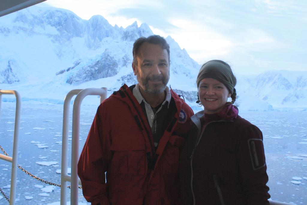 "NSIDC lead scientist Ted Scambos and Erin Pettit, glaciologist at University of Alaska, Fairbanks, pause for a picture in front of the peaks and glaciers ringing Beascochea Bay during the 2013 LARISSA Project.  The Larsen Ice Shelf System, Antarctica (LARISSA) Project is a large, interdisciplinary, multi-institute study to explore every aspect of the deteriorating Larsen Ice Shelf region in Antarctica. Participating researchers set up instruments on the glaciers that feed into the remaining portion of the Larsen ice shelf. As changes occur on the ice, the stations will record it in data and pictures. (Credit: Ted Scambos, NSIDC) Read about the project on <a href=""http://iceshelf.wordpress.com"">http://iceshelf.wordpress.com</a>. (<a href=""/cryosphere/gallery/photo/34126"">View photo detail.</a>) <br>"