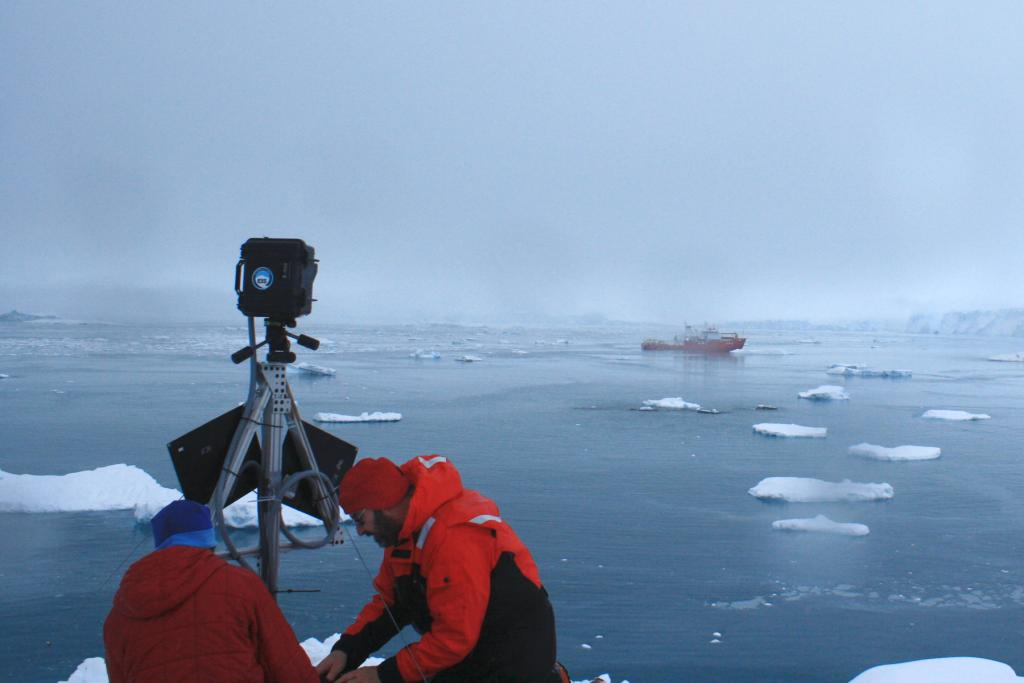 "Amy Leventer of Colgate College and Ronald Ross install an Extreme Ice Survey camera at Spring Point overlooking the Cayley Glacier calving front to the east, with the R/V Araon in the foreground.  The Larsen Ice Shelf System, Antarctica (LARISSA) Project is a large, interdisciplinary, multi-institute study to explore every aspect of the deteriorating Larsen Ice Shelf region in Antarctica. Participating researchers set up instruments on the glaciers that feed into the remaining portion of the Larsen ice shelf. (Credit: Ted Scambos, NSIDC) Read the expedition blog on <a href=""http://iceshelf.wordpress.com"">http://iceshelf.wordpress.com</a>. (<a href=""/cryosphere/gallery/photo/34149"">View photo detail.</a>) <br>"