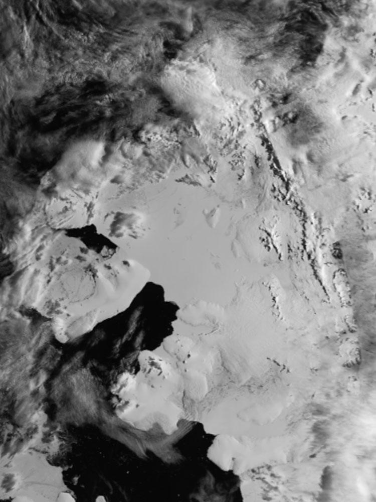 "AVHRR image acquired on 14 January 1999 showing the once intact Wilkins Ice Shelf, Antarctica. View pre- and post-collapse images of the ice shelf at the Images of Antarctic Ice Shelves Web site. (<a href=""/cryosphere/gallery/photo/33600"">View photo detail.</a>) <br>"