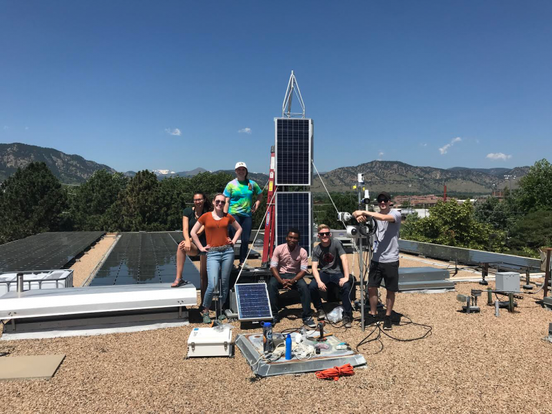 Team JANE assembled the AMIGOS towers on the top of the NSIDC building in Boulder, Colorado, so they could test it undisturbed. From left to right: Skylar Edwards, Raymie Fotherby, Emma Tomlinson, Coovi Meha, Ryan Weatherbee, and Jack Soltys.