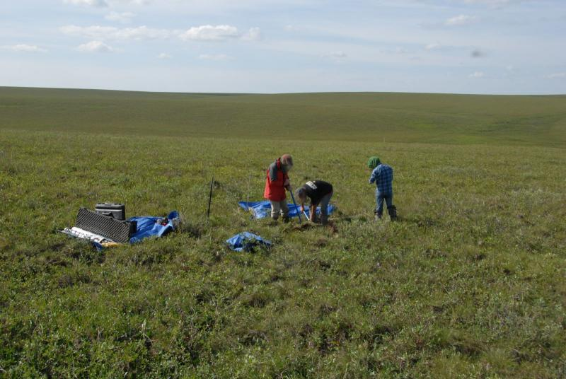 Researchers drill a permafrost core in Alaska