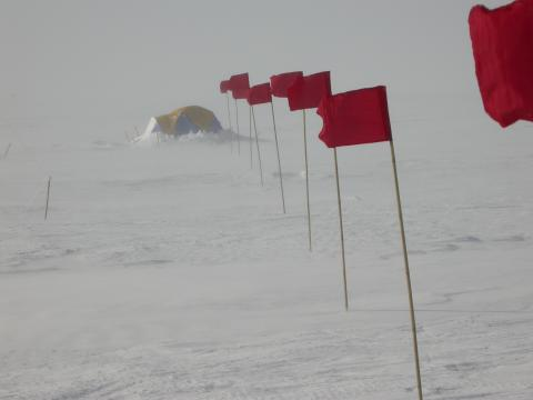 Blowing snow conditions at a camp site near Vostok Station in Antarctic summer.