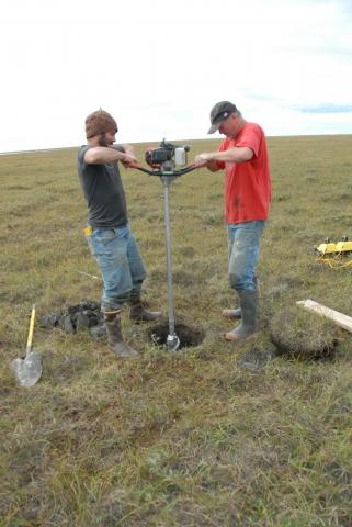 Alessio Gusmeroli and Tim Schaefer drill a permafrost core on the North Slope of Alaska near Deadhorse. Credit: Kevin Schaefer, NSIDC
