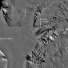 This grayscale image of the East Antarctic Ice Sheet shows the Recovery Ice Stream flowing out of the rugged Shackleton Range Mountains and merging into Filchner Ice Shelf. The image is from the Mosaic of Antarctica, a map of digital images of the continent based on observations collected by the Moderate Resolution Imaging Spectroradiometer (MODIS) on NASA's Terra and Aqua satellites. Credit—National Snow and Ice Data Center, MODIS Mosaic of Antarctica. High-resolution image